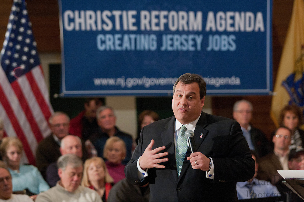 New Jersey Governor Chris Christie ansewers an question from the  audience during a town hall meeting at the John Paul II Center in West Deptford NJ.