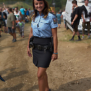 It's not every day you meet police in mini skirts, hip belts and heels. When you do, you must ask to take a picture.