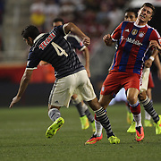 Robert Lewandowski, (right), FC Bayern Munich, is fouled by Jair Pereira, Chivas,  during the FC Bayern Munich vs Chivas Guadalajara, Audi Football Summit match at Red Bull Arena, New Jersey, USA. 31st July 2014. Photo Tim Clayton