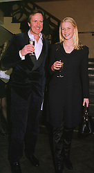 MISS SOPHIE BURRELL and MR BEN HOLLAND-MARTIN he is a friend of the Royal Family, at a dinner in London on 10th March 1999.MPG 13