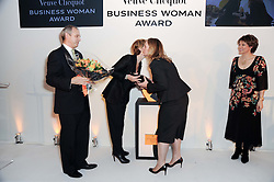 Left to right, GRAHAM BOYES, SABINA BELLI, LOUISE WYMER and KATE SILVERTON at the presentation of the Veuve Clicquot Business Woman Award 2010 held at the Institute of Contemporary Arts, 12 Carlton House Terrace, London on 23rd March 2010.  The winner was Laura Tenison - Founder and Managing Director of JoJo Maman Bebe.
