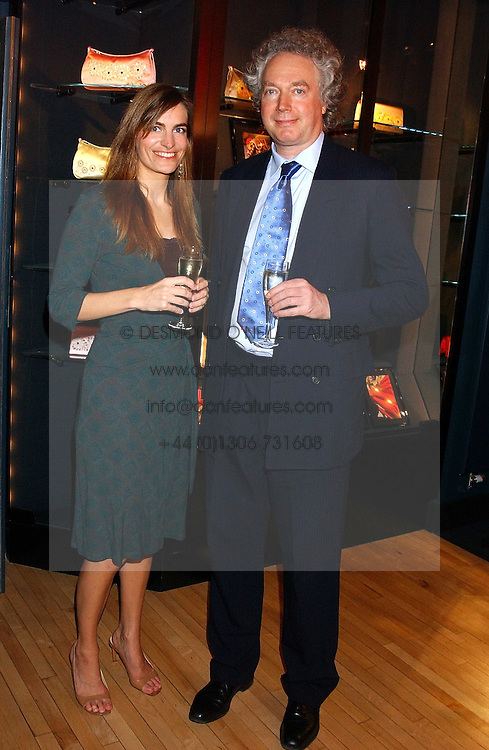 NADINE MONTROSE and CHARLES CHOLMONDELEY at a party tp celebrate the opening on Sac Freres at 7 Grafton Street, London W1 on 27th October 2005.<br />