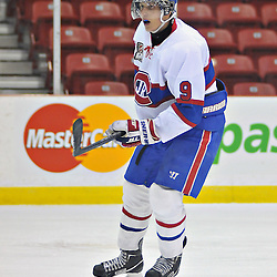 TORONTO, ON - Nov 10: Ontario Junior Hockey League game between Toronto Jr. Canadiens and Toronto Lakeshore Patriots. Adam Logozzo #9 of the Toronto Junior Canadiens during third period game action..(Photo by Shawn Muir / OJHL Images)