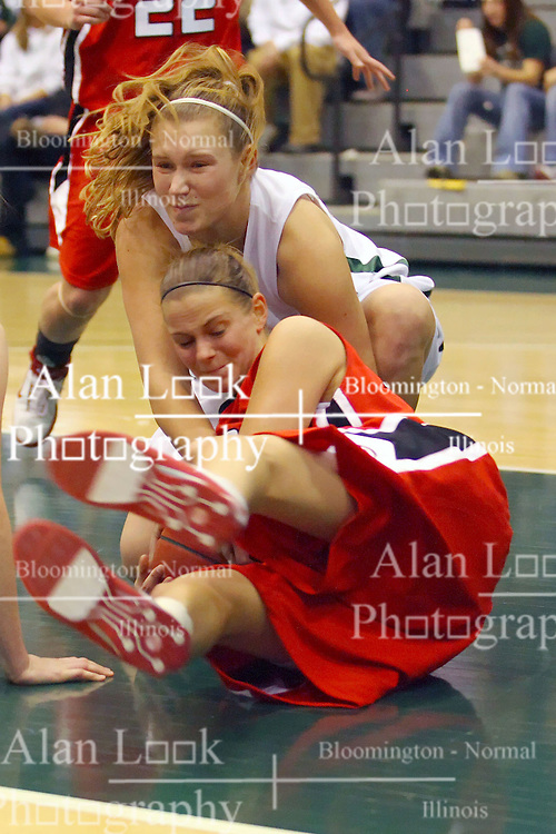 10 January 2009: Stacey Arlis  gets a shared ball decision reaching over Katie Klemke as they both retrieve a loose ball. The Illinois Wesleyan Titans, ranked #1 in the latest USA Today/ESPN poll, take down the Lady Reds of Carthage and remain undefeated,  2-0 in the CCIW and over all to 12-0. This is the first time in the history of the Lady Titans Basketball they have been ranked #1 The Titans and Lady Reds played in the Shirk Center on the Illinois Wesleyan Campus in Bloomington Illinois.