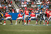 The Kansas City Chiefs offensive line makes a move at the snap of the ball in a shotgun formation during the 2018 regular season week 1 NFL football game against the Los Angeles Chargers on Sunday, Sept. 9, 2018 in Carson, Calif. The Chiefs won the game 38-28. (©Paul Anthony Spinelli)