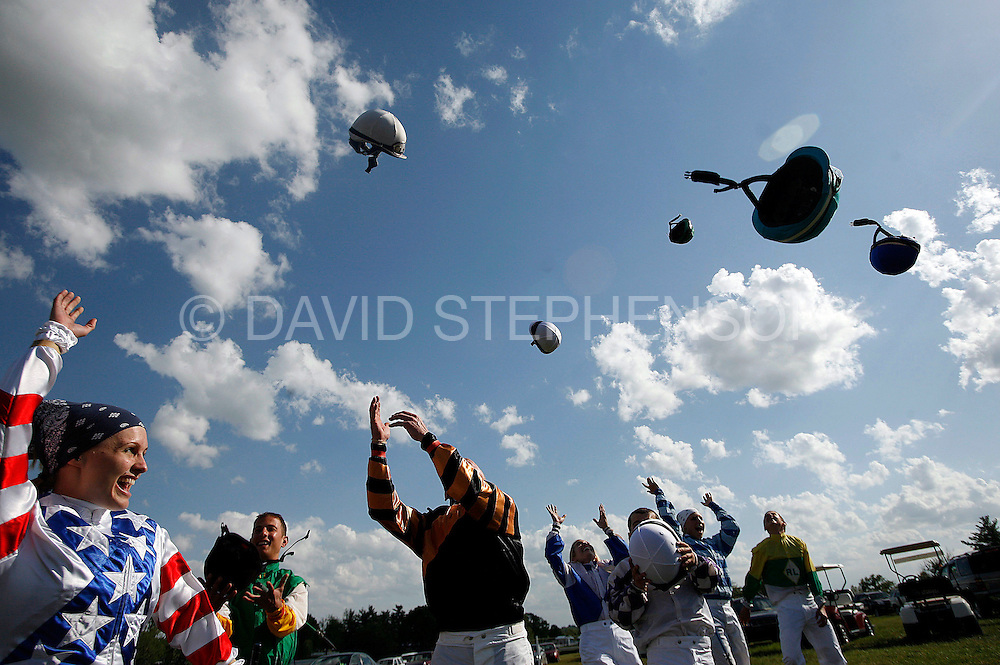 In the tradition of graduates tossing their mortarboards, eight graduating members of the North American Racing Academy (NARA) tossed their riding helmets in the air before they competed in their first race, held in conjunction with the High Hope Steeplechase at the Kentucky Horse Park in Lexington, Ky., on Sunday, May 18, 2008. Photo by David Stephenson | Staff 5766
