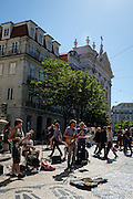Musicians perform in Lisbon's Chiado district.
