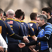 Washington and NYPD players shake hands after their rugby match during the Four Leaf 15's Club Rugby Tournament at Randall's Island New York. The tournament included 70 teams in 6 divisions, organized by the New York City Village Lions RFC. Randall's Island, New York, USA. 23rd March. Photo Tim Clayton