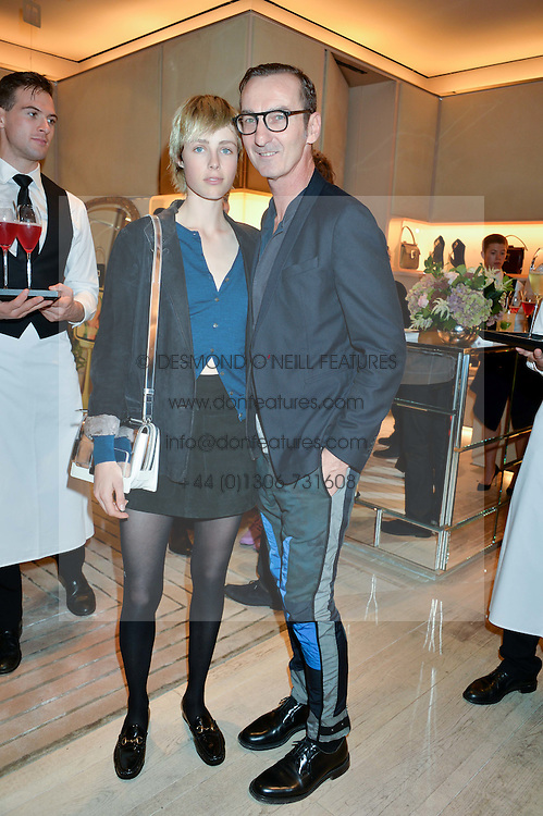 EDIE CAMPBELL and BRUNO FRISONI at the Roger Vivier 'The Perfect Pair' Frieze cocktail party celebrating Ambra Medda & 'Miss Viv' at the Roger Vivier Boutique, Sloane Street, London on 15th October 2014.