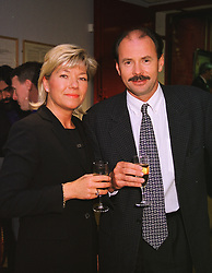 MISS HELEN ISACS and former Olympic swimming champion DAVID WILKIE at an auction in London on 28th April 1999.  MRL 43