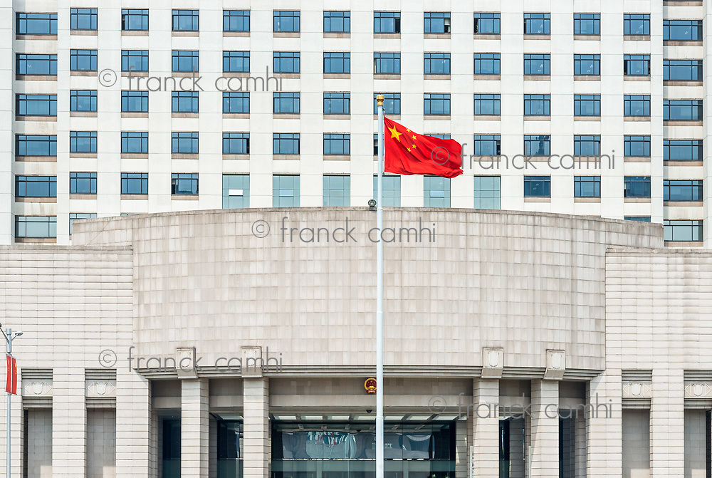 Shanghai, China - April 7, 2013: official chinese military government building on people square Shanghai in popular republic of China on april 7th, 2013