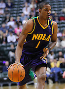 Feb. 21, 2012; Indianapolis, IN, USA; New Orleans Hornets small forward Trevor Ariza (1) d\brings the ball up court against the Indiana Pacers at Bankers Life Fieldhouse. Indiana defeated New Orleans 117-108. Mandatory credit: Michael Hickey-US PRESSWIRE