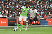 Nigeria Alex Iwobi (18) dribbling and beating England Ashley Young (3) during the Friendly International match between England and Nigeria at Wembley Stadium, London, England on 2 June 2018. Picture by Matthew Redman.