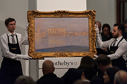 "© Licensed to London News Pictures. 03/03/2016. London, UK.  Claude Monet's ""Le Palais Ducal Vu De Saint-Georges Majeur"" (sold for a hammer price of 10.2m), at Sotheby's Impressionist, Modern & Surrealist art evening sales in New Bond Street.  The combined total of the sale was forecast to realise between £97-138m. Photo credit : Stephen Chung/LNP"