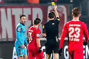 ENSCHEDE - 17-12-2016, FC Twente - AZ, Grolsch Velst Stadion, scheidsrechter Jochem Kamphuis geeft de gele kaart aan AZ speler Muamer Tankovic.