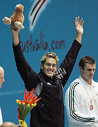 New Zealand's Moss Burmester celebrates after winning Gold in the Mens 200m Butterfly final at the Swimming at the XVIII Commonwealth Games, Melbourne, Australia, Wednesday, March 16 2006. Photo: Michael Bradley/PHOTOSPORT
