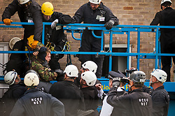 Bailiffs retrieve a housing activist from a cherry picker used for evictions from the Sweets Way housing estate on 23rd September 2015 in London, United Kingdom. A group of housing activists calling for better social housing provision in London had occupied some of the properties on the 142-home estate in Whetstone, in some cases refurbishing properties intentionally destroyed by the legal owners following eviction of the original residents, in order to try to prevent the eviction of the last resident on the estate and the planned demolition and redevelopment of the entire estate by Barnet Council and Annington Property Ltd.