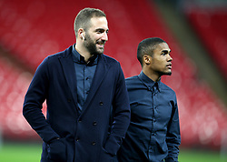 Juventus Gonzalo Higuain (left) and Douglas Costa on the pitch before the press conference at Wembley Stadium, London.