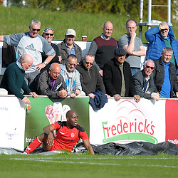 TELFORD COPYRIGHT MIKE SHERIDAN 6/4/2019 - Theo Streete of AFC Telford doesn't find much sympathy among the Chorley fans after he's shoved into the advertising boards during the Vanarama Conference North fixture between Chorley FC and AFC Telford United at Victory Park