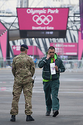 © licensed to London News Pictures. London, UK 20/07/2012. A G4S security staff goes through Stratford gate of the Olympic site which is secured by soldiers on 20/07/12. Photo credit: Tolga Akmen/LNP