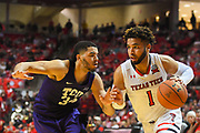 LUBBOCK, TX - MARCH 3: Brandone Francis #1 of the Texas Tech Red Raiders drives to the basket against Kenrich Williams #34 of the TCU Horned Frogs during the game on March 3, 2018 at United Supermarket Arena in Lubbock, Texas. Texas Tech defeated TCU 79-75. Texas Tech defeated TCU 79-75. (Photo by John Weast/Getty Images) *** Local Caption *** Brandone Francis;Kenrich Williams
