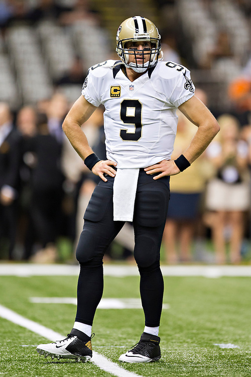 NEW ORLEANS, LA - SEPTEMBER 21:  Drew Brees #9 of the New Orleans Saints warms up before a game against the Minnesota Vikings at Mercedes-Benz Superdome on September 21, 2014 in New Orleans, Louisiana.  The Saints defeated the Vikings 20-9.  (Photo by Wesley Hitt/Getty Images) *** Local Caption *** Drew Brees