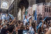 Italy, Siena, the Palio: Italy, Siena, the Palio: Carlo Sanna called Brigante is the wnner jockey of the Onda Contrada; he will be acarried throw the streets to the Duomo to sing the Deum in Thanksgiving