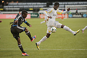 San Jose Earthquakes Cordell Cato (37 Black) nails AIK's Edward Owusu (White - 23) with a kick in MLS preseason tournament action at Portland, Oregon's Jeld Wen Field. The game ended in a 0-0 draw.