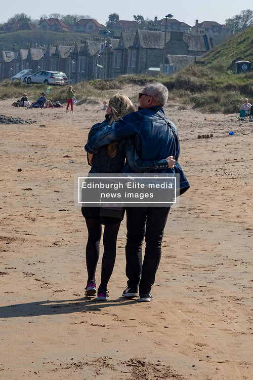 Pictured: <br /> Visitors to North Berwick enjoyed an old fashioned beach break with kids, dogs, adlults hiding behind windbreaks and temperatures of 23 degrees. Views of the Bass Rock, which houses the largest gannet population in the world, enhanced the old tyme feeling.<br /> <br /> <br /> Ger Harley   EEm 22 April 2019
