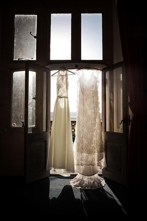 The Bride's wedding dresses hanging up at the beautiful Eynsham Hall