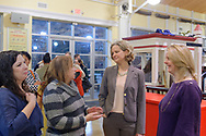 Garden City, New York, USA. March 9, 2019.  L-R, Jean Smyth-Crocetto, Karen Montalbano, Nassau County Executive Laura Curran, and Nassau County Legislator Debra Mulé (5th L. D.) chat during Unveiling Ceremony of Michael White's mural of Nunley's Carousel lead horse. Event was  held at historic Nunley's Carousel in its Pavilion on Museum Row on Long Island.