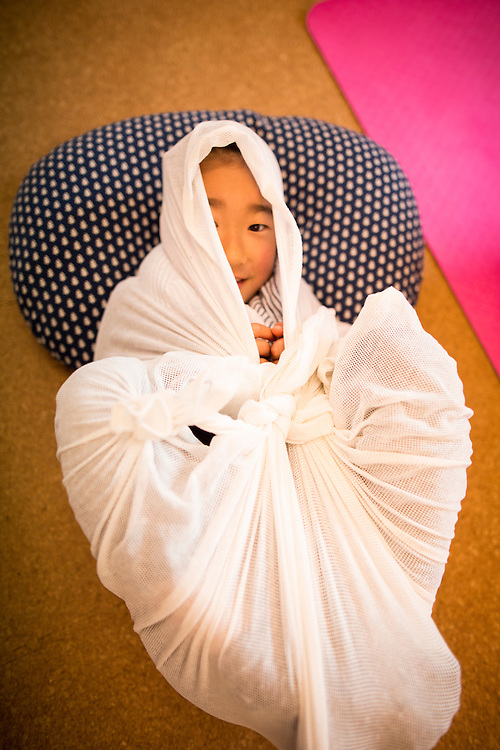 "TOKYO, JAPAN - JANUARY 29 : Participant wrapped in a white cloth during a workshop called ""Otonamaki"", which directly translates to adult wrapping, Tokyo, Japan on Sunday, January 29, 2017. Otonamaki is a Japanese therapeutic method meant to alleviate posture problems and stiffness. (Photo by Richard Atrero de Guzman/ANADOLU Agency)"