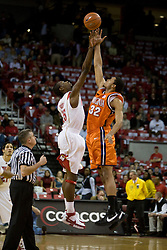 Virginia forward Mike Scott (32) and Maryland forward James Gist (15) go up for the opening tip. The Maryland Terrapins defeated the Virginia Cavaliers men's basketball team 85-75 at the Comcast Arena in College Park, MD on January 30, 2008.