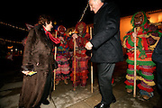 "Cavaco Silva and his wife Maria Cavaco Silva, dance with typical ""caretos"" in Braganca, a northern portuguese town. The ""caretos"" are young men that wear typical masks and uniforms in Christmas and Carnival time, and follow girls and make tricks with the population of some small villages in the north of Portugal. Some people are organizing in a movement to candidate this popular cultural expression to UNESCO Heritage."