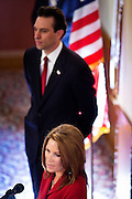 17 OCTOBER 2011 - PHOENIX, AZ:  Arizona State Sen. STEVE SMITH, background, listens to MICHELE BACHMANN, a Republican candidate for US President, talk about border security. Bachmann met with Republican Arizona legislators and Republican members of the state's Congressional delegation Monday morning to talk about illegal immigration and border security. During the meeting she pledged that if she were elected US President, she would construct a fence along the US - Mexico border.   PHOTO BY JACK KURTZ