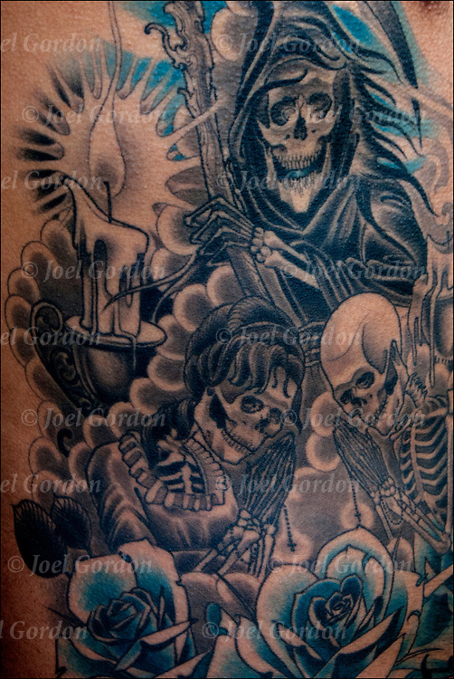 Tattoo of Grim Reaper on side of Hispanic Mexican American.<br />