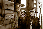 LB00142-01...WYOMING - Bobby Picklesimer and Clint Black in the barn at Willow Creek Ranch.  MR# P10 - B19