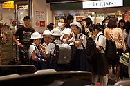 May 23, 2019: Tokyo, Japan: On the Keio Line, a major commuter line stretching out to the western suburbs of Tokyo, an unidentified person committed suicide by jumping into an oncoming train at Kami-kitazawa Station at approximately 3:35 PM. This caused over an hour long disruption of service for hundreds of thousand of commuters in both directions, just before the start of the evening rush hour. At nearby Tsutsujigaoka Station where these photos were taken, commuters were abruptly stranded as station employees scrambled to diffuse the situation. Many were provided alternate transportation by bus lines, while others just waited it out. Although Japan has seen a decrease in suicides which peaked at over 32,000 deaths in 2003, it still ranks high among major industrialized countries with around 20,000 suicides per year. This is now the leading cause of death among youths aged ten to fourteen. Photo by Torin Boyd.