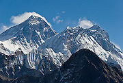 "Left to right are: Mount Everest, Nuptse, and Lhotse, as seen from Gokyo Ri. Mount Everest (29,035 feet / 8850 meters elevation above sea level, from 1999 GPS measurement), the highest mountain on Earth, was first called Chomolungma or Qomolangma (""Goddess Mother of the Earth"" in Tibetan). In 1865, Andrew Waugh, the British surveyor-general of India named the mountain for his chief and predecessor, Colonel Sir George Everest. In the 1960s, the Government of Nepal named the mountain Sagarmatha, meaning ""Goddess of the Sky"". The mountain, which is part of the Himalaya range in High Asia, is located on the border between Nepal and Tibet, China. Sagarmatha National Park was created in 1976 and honored as a UNESCO World Heritage Site in 1979."