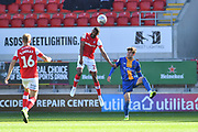 Rotherham United player Michael Ihiekwe (20) and Shrewsbury Town player Callum Lang (9) during the EFL Sky Bet League 1 match between Rotherham United and Shrewsbury Town at the AESSEAL New York Stadium, Rotherham, England on 21 September 2019.
