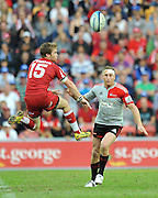 Ben Lucas attempts to charge down the clearing kick from Brent Ward ~ Super 15 rugby (Round 15) - Reds v Crusaders played at Suncorp Stadium, Brisbane, Australia on Sunday 29th May 2011 ~ Photo : Steven Hight (AURA Images) / Photosport