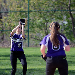 Staff photos by Tom Kelly IV<br /> Upper Darby's A. Anderson (3) catches a popup in the outfield during the Ridley at Upper Darby softball game on Wednesday.