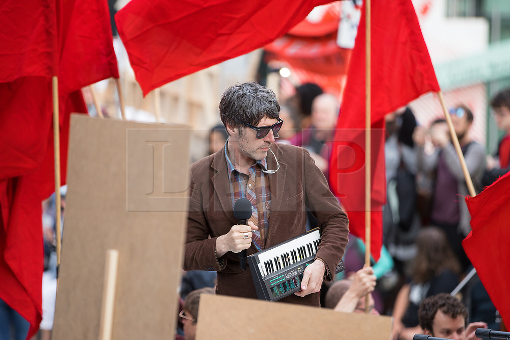 "© Licensed to London News Pictures . 16/07/2017 . Manchester , UK . Gruff Rhys of the Super Furry Animals performs "" Communism's Coming Home"" at the closing event of the Manchester International Festival at Home arts venue (formally the Cornerhouse) in Manchester City Centre , featuring dance, music, socialist workshops , all in the shadow of the newly unveiled statue of Friedrich Engels , at Tony Wilson Place . Photo credit : Joel Goodman/LNP"