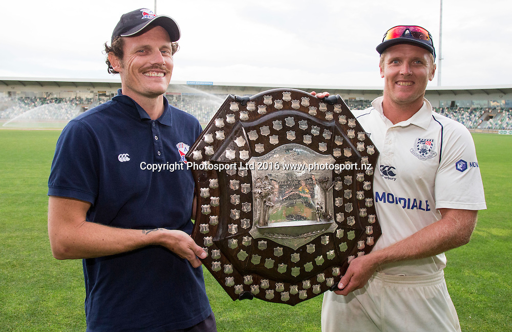 Auckland Ace's co captains, Rob Nicol and Michael Bates celebrate with the Shield. Plunket Shield Cricket, McLean Park, Napier, New Zealand. Saturday, 02 April, 2016. Copyright photo: John Cowpland / www.photosport.nz