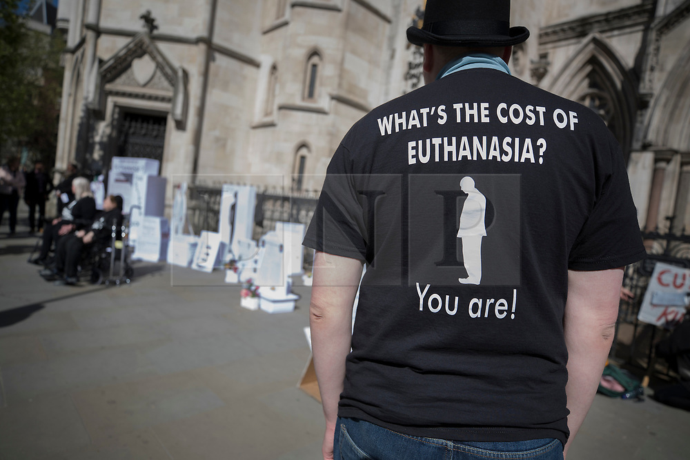 """© Licensed to London News Pictures. 01/05/2018. London, UK. A member of disability group 'The Distant Voices', which campaigns against euthanasia, stands outside the High Court as terminally ill man Noel Conway challenges the law on assisted suicide. Mr Conway, who has motor neurone disease, is asking judges to acknowledge his """"basic right to die"""". Photo credit: Peter Macdiarmid/LNP"""