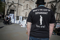"© Licensed to London News Pictures. 01/05/2018. London, UK. A member of disability group 'The Distant Voices', which campaigns against euthanasia, stands outside the High Court as terminally ill man Noel Conway challenges the law on assisted suicide. Mr Conway, who has motor neurone disease, is asking judges to acknowledge his ""basic right to die"". Photo credit: Peter Macdiarmid/LNP"