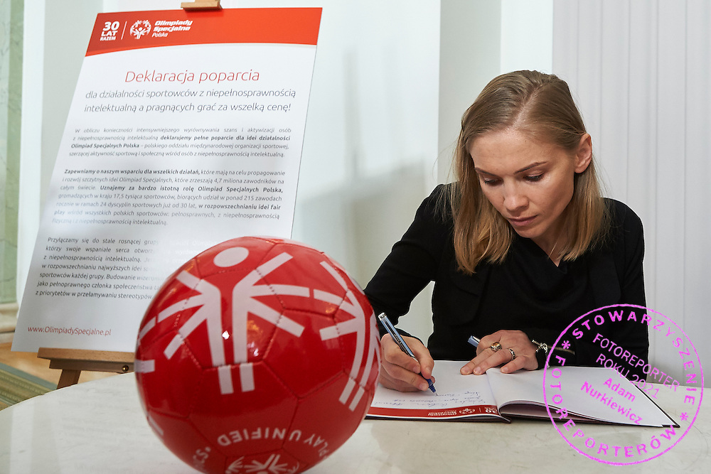 Kinga Baranowska - Polish mountaineer poses to photo with disability athlete during 30 years anniversary of The Special Olympics Poland at Presidential Palace in Warsaw on March 18, 2015.<br /> <br /> Poland, Warsaw, March 18, 2015<br /> <br /> For editorial use only. Any commercial or promotional use requires permission.<br /> <br /> Mandatory credit:<br /> Photo by &copy; Adam Nurkiewicz / Mediasport