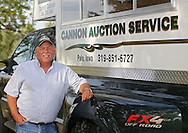 Darrell Cannon of Cannon Auction Service with his auction truck at his house in Palo on Tuesday, September 10, 2013.