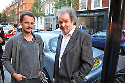 Left to right, JONATHAN YEO and MIKE FIGGIS at a private view of an exhibition of photographs by Mike Figgis entitled 'Kate & Other Women' held at The Little Black Gallery, 13 A Park Walk, London SW10 on 22nd June 2011.