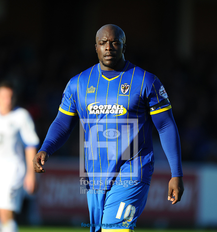 Adebayo Akinfenwa of AFC Wimbledon during the Sky Bet League 2 match at the Cherry Red Records Stadium, Kingston<br /> Picture by Seb Daly/Focus Images Ltd +447738 614630<br /> 11/10/2014